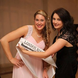 Aisling is presented with her sash by last year.s rose Seoirse Ni Fhaitnain.