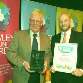 John Nolan accepts the award for Culture from Leader of the Council Cllr Peter Lamb